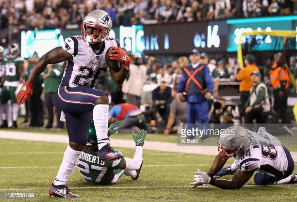 Sony Michel of the New England Patriots rushes for a touchdown in the first quarter against the New York Jets during their game at MetLife Stadium on...