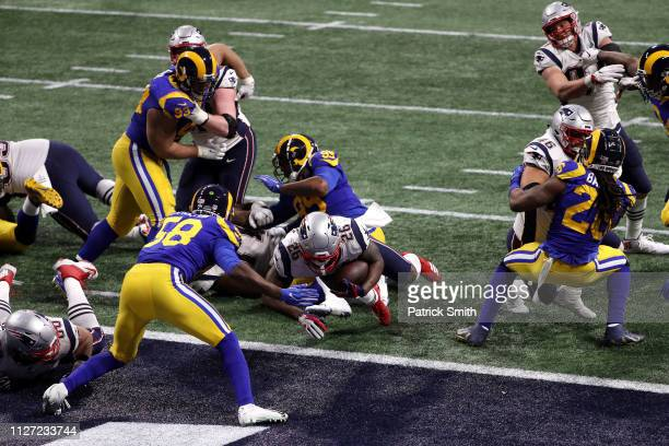 Sony Michel of the New England Patriots scores a fourth quarter rushing touchdown against the Los Angeles Rams during Super Bowl LIII at MercedesBenz...