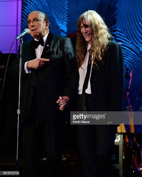 Sony Music Entertainment CCO Clive Davis speaks onstage with Patti Smith at the 55th Annual GRAMMY Awards PreGRAMMY Gala and Salute to Industry Icons...
