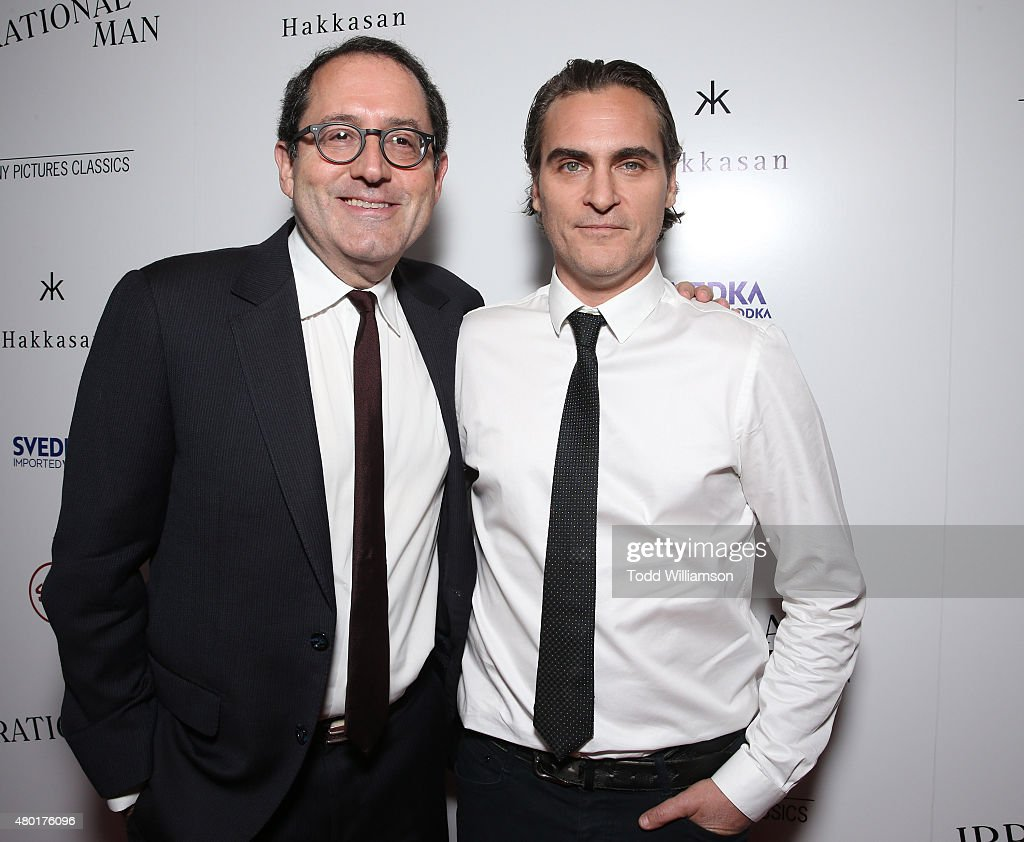Sony Pictures Classics Co-President Michael Barker (L) and Joaquin Phoenix attend the Sony Pictures Classics premiere for 'Irrational Man' hosted by Svedka Vodka, Hakkasan and Sabra at The WGA Theater on July 9, 2015 in Beverly Hills, California.
