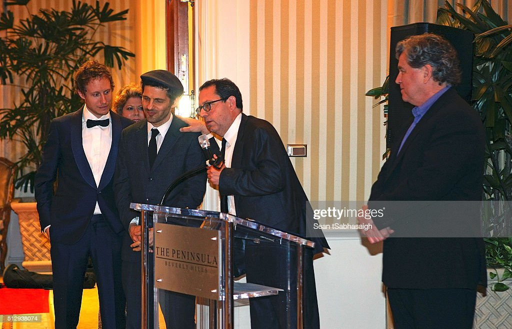 Sony Pictures Classics Co-Presidents Michael Barker and Tom Bernard (Rt) congratulate Son of Saul lead actor Geza Rohrig (Ct Lt) and director Laszlo Nemes (Lt) at the Pre-Oscar Hungarians in Hollywood Gala celebrating the Academy Award nominated film Son of Saul at the Peninsula Hotel on February 27, 2016 in Beverly Hills, California.