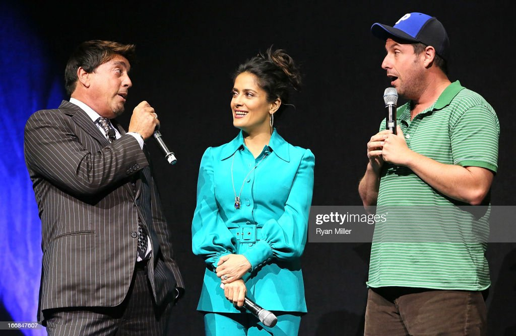 Sony Pictures' head of distribution Rory Bruer speaks with Salma Hayek and Adam Sandler, the cast of Grown Ups 2 onstage during the Sony Pictures Entertainment Invites You to an Exclusive Product Presentation Highlighting its 2013 Films at Caesars Palace during CinemaCon, the official convention of the National Association of Theatre Owners on April 17, 2013 in Las Vegas, Nevada.