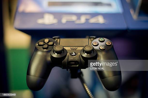A Sony Playstation 4 controller is pictured at the Gadget Show Live@Christmas at Earl's Court in London on November 1 2013 Exhbitiors gather to show...