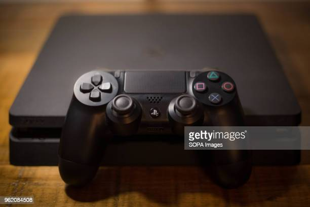 Sony PlayStation 4 video game console with a black wireless controller next to it The PlayStation 4 or PS4 is knows as the eighth generation of home...