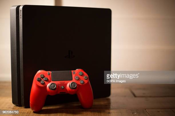 Sony PlayStation 4 video game console with a red wireless controller next to it The PlayStation 4 or PS4 is knows as the eighth generation of home...