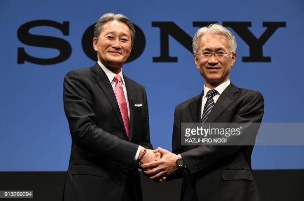 Sony president and CEO Kazuo Hirai shakes hands with executive deputy president and CFO Kenichiro Yoshida during a press briefing at the company's...