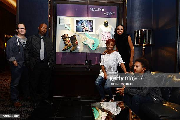 Sony Recording artist Malina Moye poses for a photo with her family during her case induction at the Hard Rock Hotel Casino on November 6 2014 in Las...