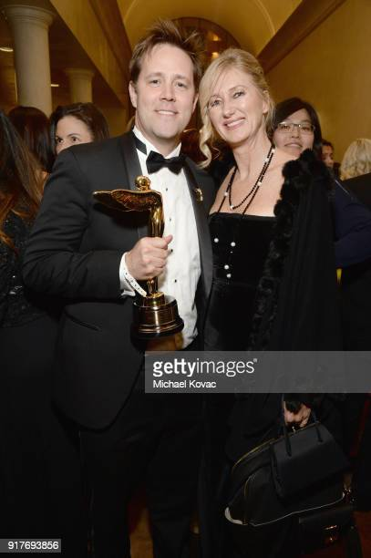 Sony SVP VR Jake Zim and AIS EVP Debbie Menin pose with the Lumiere Award at the Advanced Imaging Society 2018 Lumiere Awards presented by Dell and...
