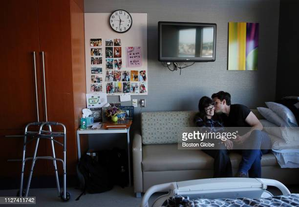 Sonya Bandouil shares a moment with her boyfriend Alex Pankiewicz in her room at Spaulding Rehabilitation Center in the Charlestown neighborhood of...