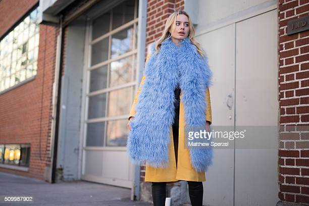 Sonya Esman is seen at Jill Stuart wearing Charlotte Simon blue vest Cameo Collective yellow coat Robert Rodriguez pants and Senso shoes during New...