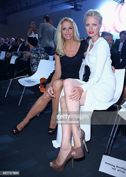 Sonya Kraus and Franziska Knuppe attend the SOliver Collection Presentation on July 26 2014 in Dusseldorf Germany