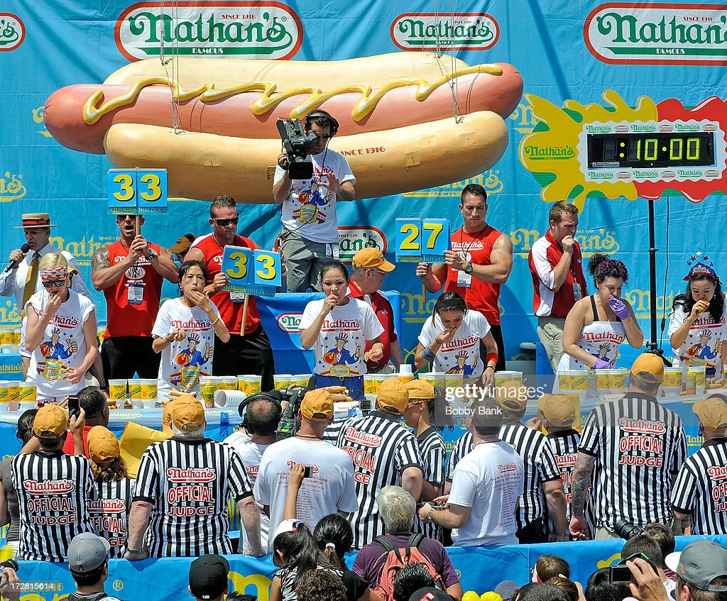 Sonya Thomas and Juliet Lee compete in the Woman's division of the 2013 Nathan's Famous Hot Dog Eating Contest at Coney Island on July 4, 2013 in New York City.