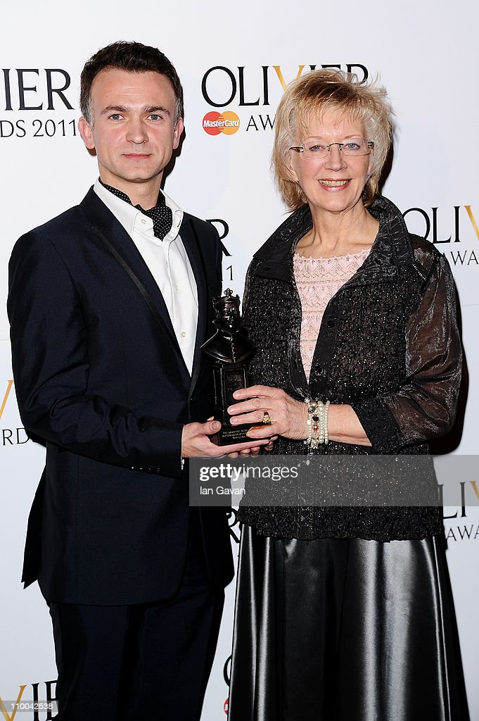 Sony's Daniel Hinchliffe and The Director of the Royal Opera House Elaine Padmore accept the award for Outstanding Achievment in Opera in the press room during The Olivier Awards 2011 at Theatre Royal on March 13, 2011 in London, England.
