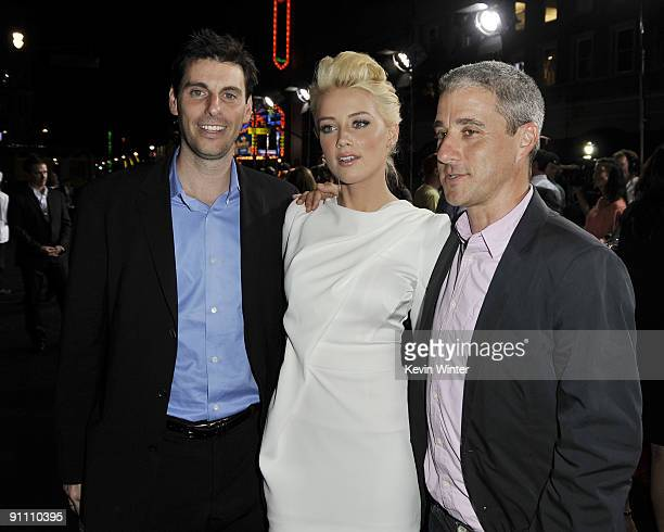 Sony's Marc Weinstock actress Amber Heard and Sony's Matt Tolmach arrive at the premiere of Sony Pictures' 'Zombieland' at the Chinese Theater on...