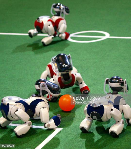 Sony's pet robots AIBO play soccer game during the fourleg league of the RoboCup Japan Open 2004 robots' soccer games in Osaka western Japan 01 May...