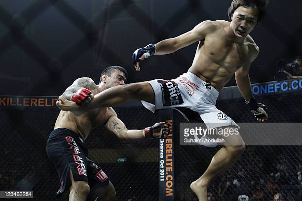 Soo Chui Kim kicks Leandro Issa during the ONE Fighting Championships bantamweight bout at Singapore Indoor Stadium on September 3, 2011 in Singapore.