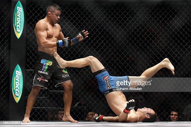 Soo Chul Kim of South Korea defends himself from Bibiano Fernandes of Brazil during the One Fighting Championship Bantamweight World Championship...