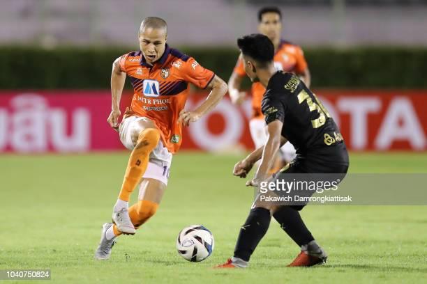Soo Il Kang of Ratchaburi Mitr Phol FC takes on Shinnaphat Leeach of Singha Chiangrai United FC during the Chang FA Cup semi final between Ratchaburi...