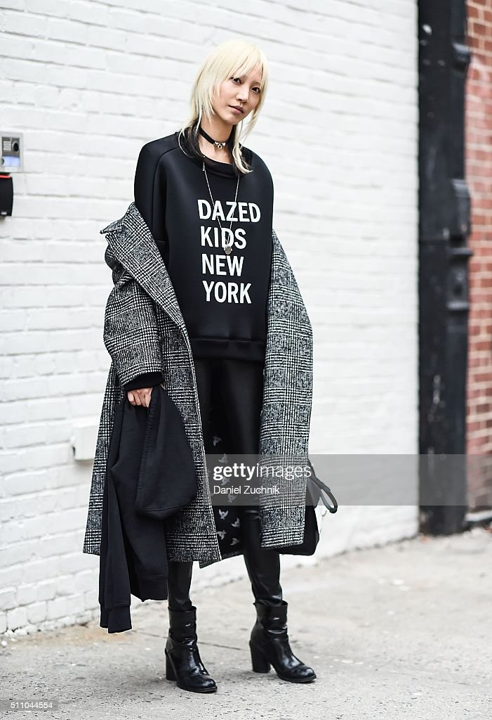 Soo Joo Park is seen outside the DKNY show wearing a DKNY sweater during New York Fashion Week: Women's Fall/Winter 2016 on February 17, 2016 in New York City.