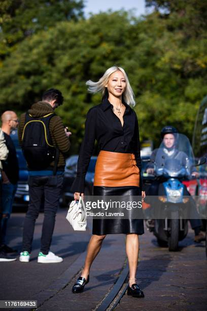 Soo Joo Park, wearing a black leather skirt and black shirt, is seen outside the Tod's show during Milan Fashion Week Spring/Summer 2020 on September...