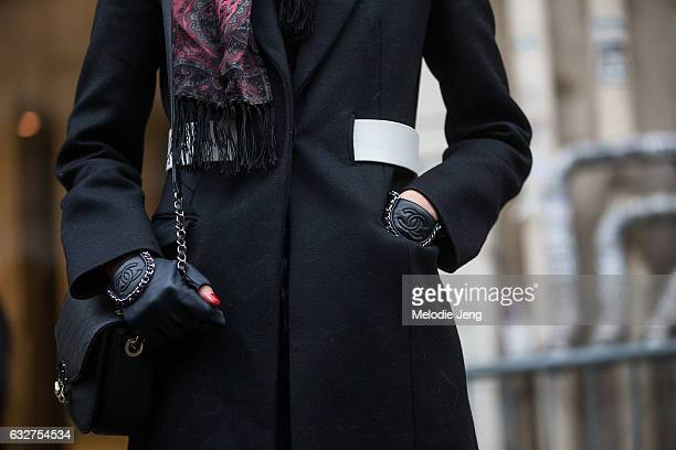 Soo Joo Park wears leahter Chanel fingerless gloves after the Jean Paul Gaultier show on January 25 2017 in Paris France