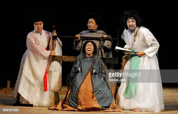 SooMe Lee as Ariel SeungHyun Lee and EunA Cho as Caliban with YoungKwang Song as Prospero in Mokwha Repertory Company's production 'The Tempest'...