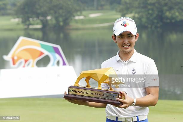 Soomin Lee of South Korea holds the trophy after winning the Shenzhen International at Genzon Golf Club on April 25 2016 in Shenzhen China
