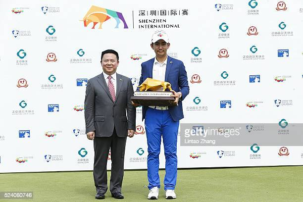 Soomin Lee of South Korea holds the trophy with Deng Xueqin Chairman and President of the Genzon group after winning the Shenzhen International at...