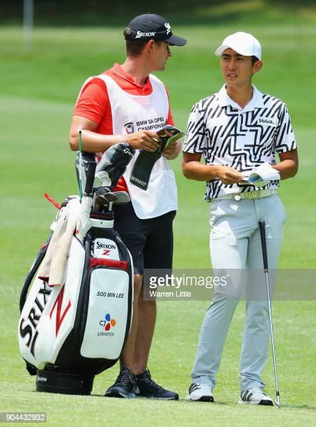 Soomin Lee of South Korea talks with his caddie on the 7th hole during day three of the BMW South African Open Championship at Glendower Golf Club on...