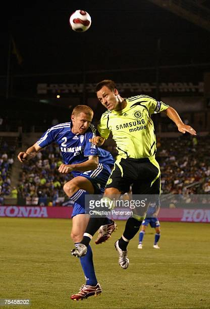 Soon Hak Hong of the Suwon Samsung Bluewings and John Terry of Chelsea FC jump for a header during the World Series of Football match at the Home...
