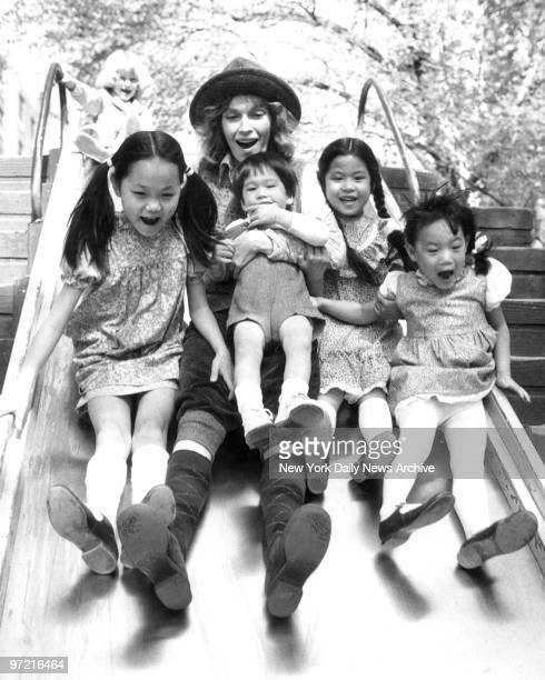 Soon Yi Previn Mia Farrow holding son Misha Lark Song and Summer enjoy ride on a slide Mia and her children were out for a day of fun in Central Park...