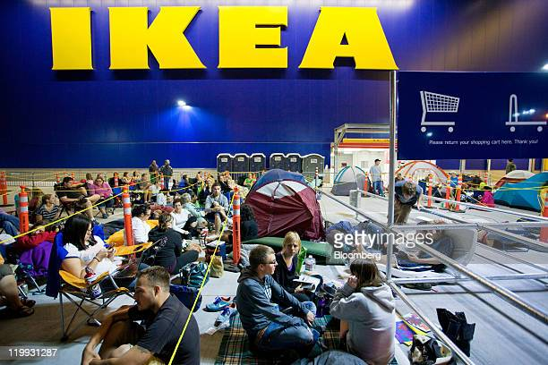 Soontobe customers some in sleeping bags and tents wait in line before dawn for the grand opening of the Ikea store in Centennial Colorado US on...