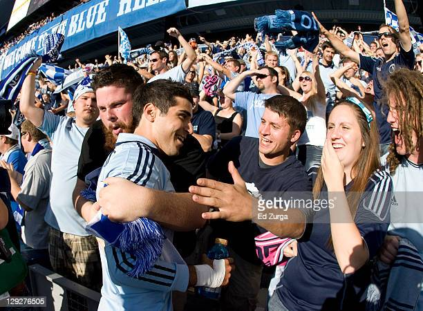 Soony Saad of Sporting Kansas City celebrates with fans a 2-0 win over New York Red Bulls at Livestrong Sporting Park on October 15, 2011 in Kansas...