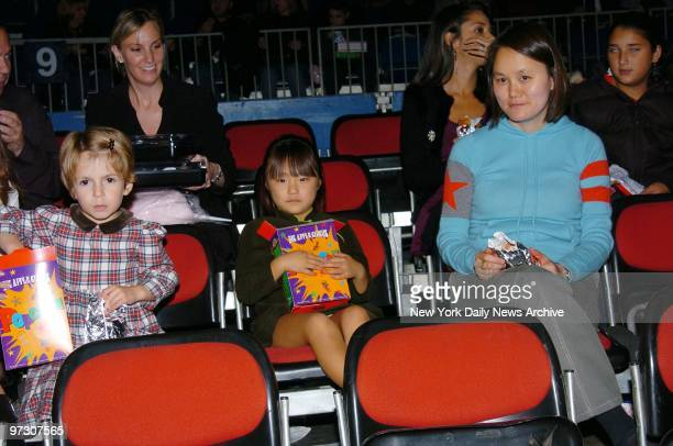 SoonYi Allen and daughters Manzie Tio and Bechet Dumaine munch on snacks during the Big Apple Circus' opening night gala benefit in Lincoln Center's...