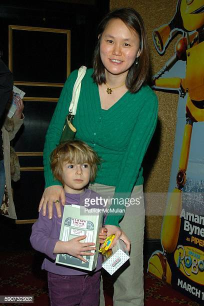 SoonYi Previn and Manzie Tio Allen attend Private Screening of Robots at Ziegfeld Theater on March 6 2005 in New York City