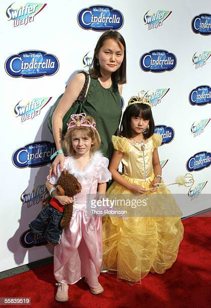 SoonYi Previn wife of actor Woody Allen and their daughters Manzie and Bechet Allen attend the Cinderella red carpet premiere in honor of the DVD...