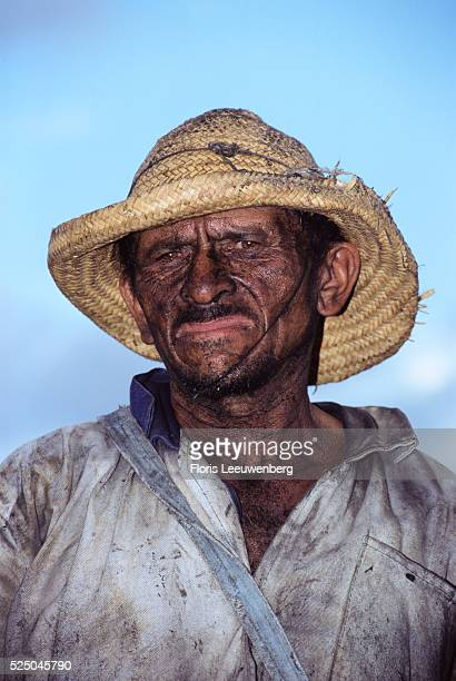 Soot Covered Man Wearing Battered Straw Hat