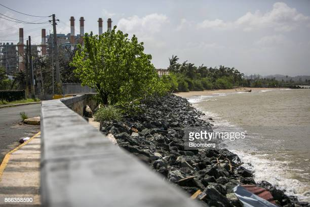 Soot covered rocks sit on a beach near the Puerto Rico Electric Power Authority Palo Seco plant in Palo Seco, Toa Baja, Puerto Rico, on Saturday,...