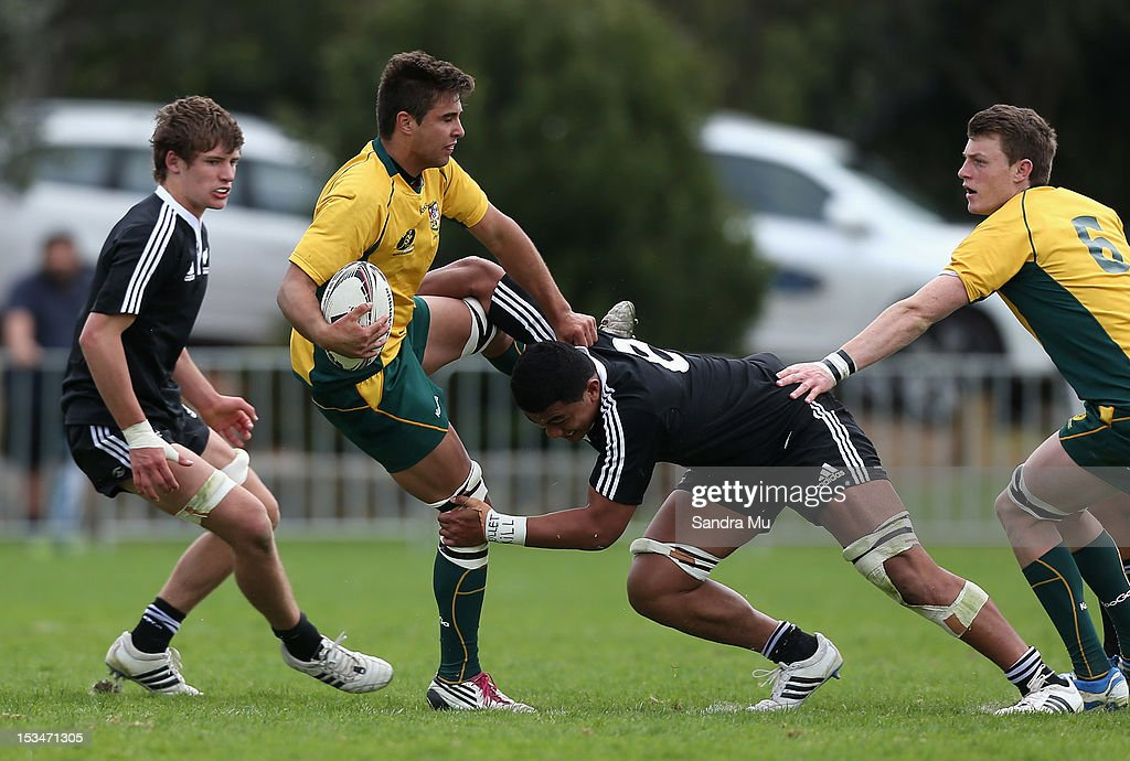 So'otala Fa'aso'o of New Zealand tackles Mitchell Whiteley of Australia during the Test between New Zealand Schools and Australia Schools at Auckland Grammar on October 6, 2012 in Auckland, New Zealand.