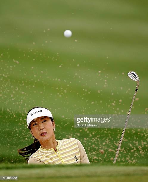 SooYun Kang of Korea plays a bunker shot on the 15th hole during the third round of the Safeway International at Superstition Mountain Golf and...