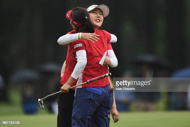 SooYun Kang of South Korea hugs Teresa Lu of Taiwan on the 18th green during the final round of the Nichirei Ladies at the on June 18 2017 in Chiba...