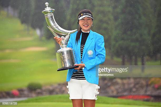 SooYun Kang of South Korea poses with the trophy after winning the Suntory Ladies Open at the Rokko Kokusai Golf Club on June 12 2016 in Kobe Japan