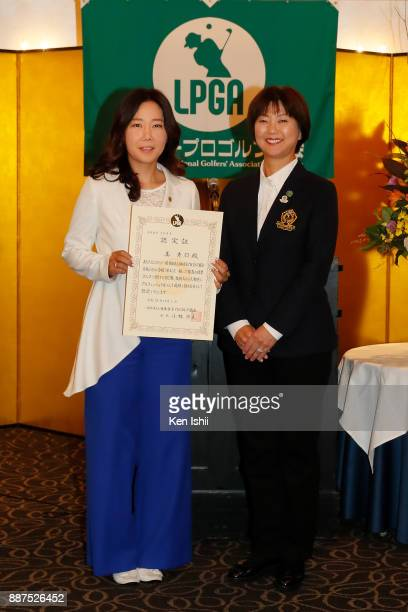 SooYun Kang of South Korea receives a certificate from LPGA president Hiromi Kobayashi during the Ladies Professional Golfers' Association of Japan...