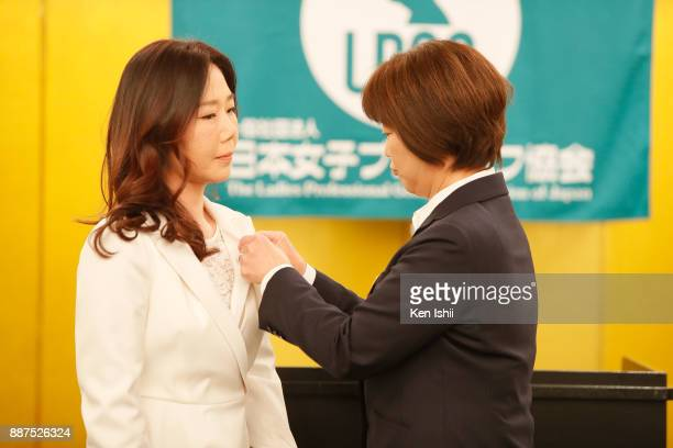 SooYun Kang of South Korea receives a lapel pin from LPGA president Hiromi Kobayashi during the Ladies Professional Golfers' Association of Japan...