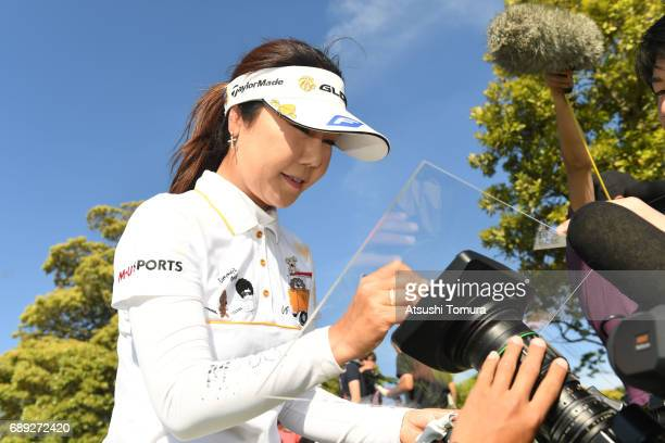 SooYun Kang of South Korea signs an autograph on the TV camera after winning the Resorttrust Ladies at the Oakmont Golf Club on May 28 2017 in...