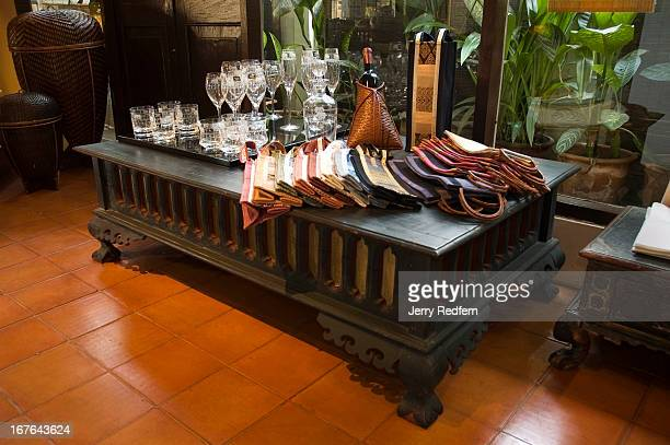 Sop Moei Arts specializes in textiles and furniture inspired by Northern Thai tribal designs Here local textiles and glasses etched with tribal...
