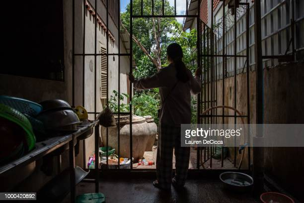 Sophea stands in the kitchen of the Cambodian Women's Crisis Center housing shelter on July 2 2018 in Phnom Penh Cambodia Sophea came to the shelter...