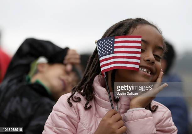 Sophia Biniam holds an American flag during a naturalization ceremony for kids between the ages of 612 at Crissy Field near the Golden Gate Bridge on...