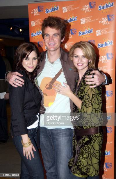 Sophia Bush Tyler Hilton and Hilarie Burton during The Cast of 'One Tree Hill' Appears at FYE in New York City February 7 2006 at FYE in New York...