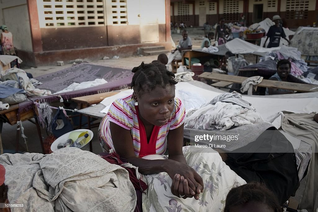 Sophia Charlite, 23-years-old is seen at her shelter in a temporary camp on January 29, 2010 in Port Au Prince, Haiti. Sophia is nine month pregnant and camping in the open air in a temporary camp that was once a school near the National Theatre, where Save the Children has a mobile clinic.She is due to give birth any day and she spent most of her time by herself as her husband can be with her as he spend all his time looking for a job. As many as 200,000 people died on January 12 as a consequence of the 7.0-magnitude earthquake. At least 130 people have been pulled alive from the rubble. An estimated 1.5 million people have been left homeless. The Haitian government is planning to relocate some 400,000 people, currently in makeshift camps across the capital, to temporary tent villages outside the city. Aid agencies are still struggling to supply food and water to survivors, while thousands of Haitians who suffered serious injuries remain in need of urgent medical attention.